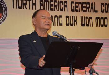 Grand Master Nguyen Kim Châu seen addressing the North America General Confederation of Kang Duk Won Moo Do in 2015