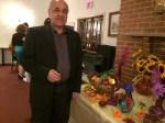 دکتر اقتداری در کنار میز پائیزی جشن مهرگان ۱۳۹۳ کانون