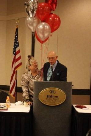 Carol is presented with a special gift from Steve Proffitt