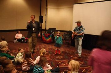 """Aaron McKee, the children and Mr. Stinky Feet - Jim Cosgrove singing """"This little light of mine"""" and sharing the light with all in attendance."""