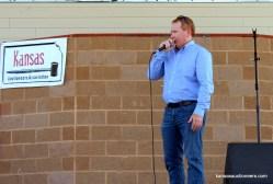 2015 Kansas Auctioneer Championship finals judge, Troy Lippard, sells an item.