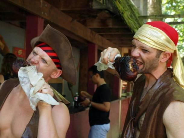 Kansas City Renaissance Festival - two guys eating turkey legs
