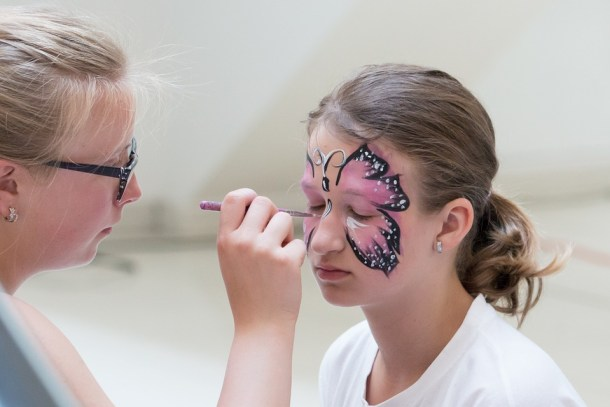 Kansas City fall festivals - woman face painting a young girl