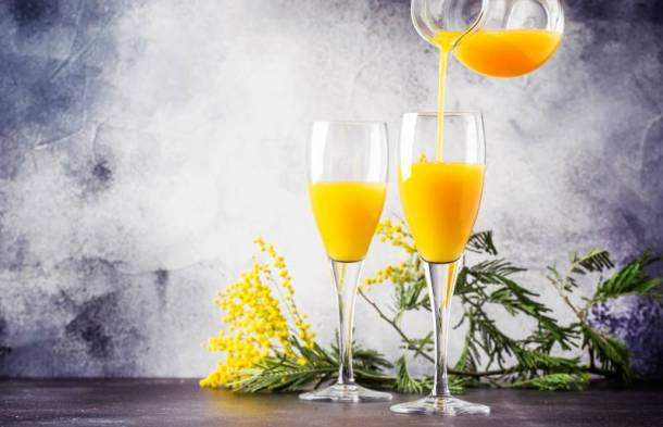 Mother's Day Dining Specials in Kansas City - two mimosa glasses