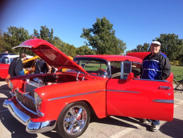 Kansas City Fall Festivals - man standing by classic car at car show