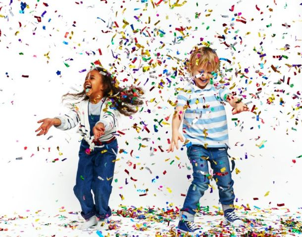 New Year's Eve Parties for kids in Kansas City - two kids dancing in confetti