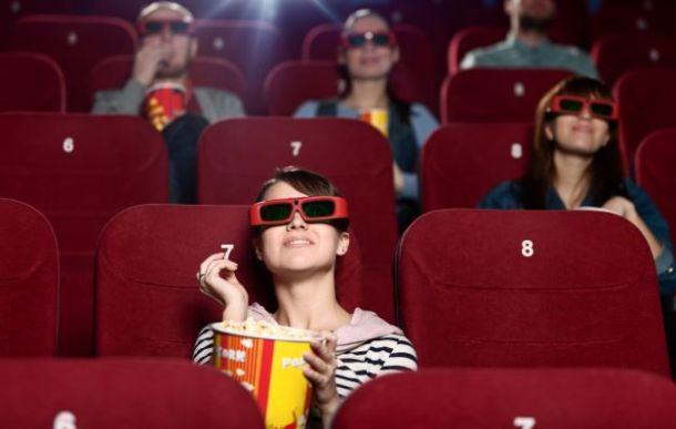 Kid watching movie in a theatre