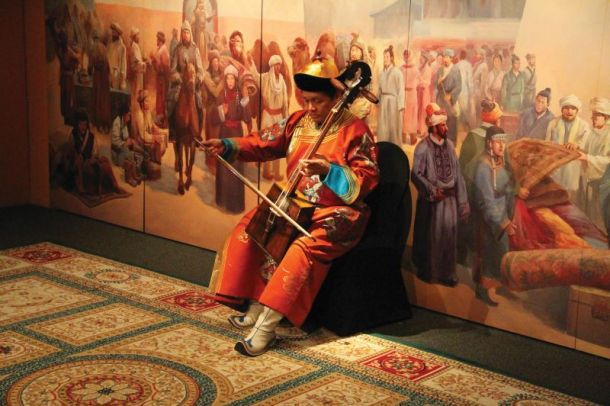 Genghis Khan exhibit at Union Station Kansas City - traditional Mongolian musician playing an instrument