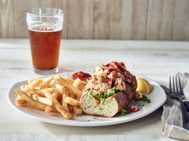 Kansas City Restaurant Deals - Plate of lobster roll with fries and a glass of beer