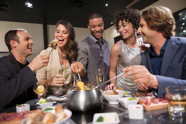 Melting Pot holiday events and offers - five friends eating fondue