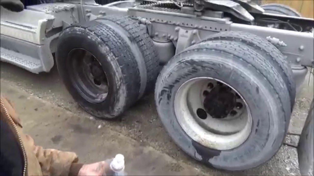 truck tire repair 2  finding a leak, tighten valve stem.