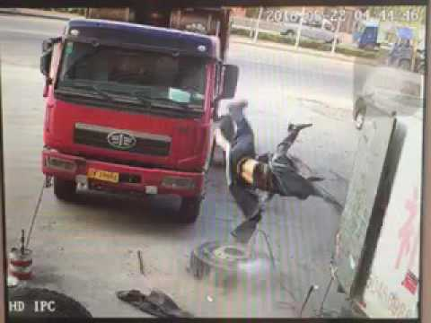 China Accident Exploding Truck Tire throws mechanic through the air tire repair