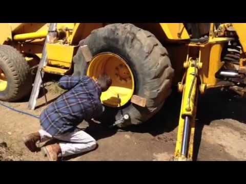 Tractor tire Repair!  Starter Fluid & Match.  Boom!