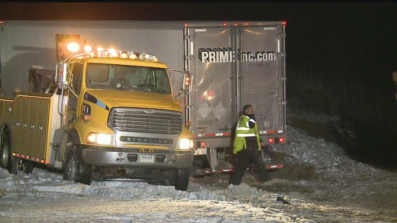 Man hit by semi while changing tire along I-80