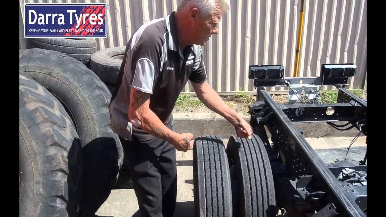 Inspecting Truck tyres for abnormal wear.