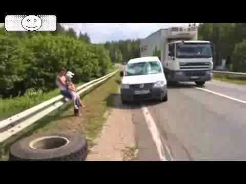 Truck tires comes loose and scores a double hit