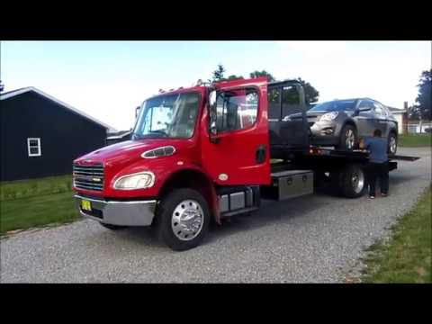 New Freightliner hauls my car to repair shop