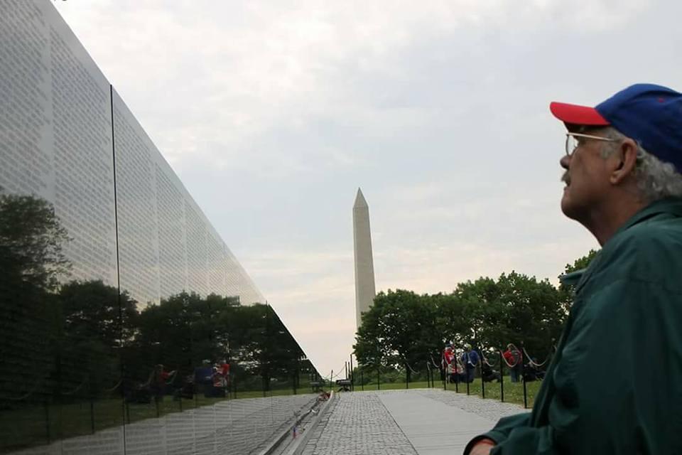A Kansas Honor Flight veteran at the Vietnam Memorial Wall