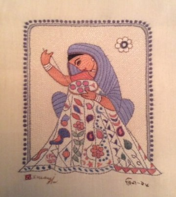 Woman embroidering kantha.  Surayia Rahman design.  Photo used with permission.