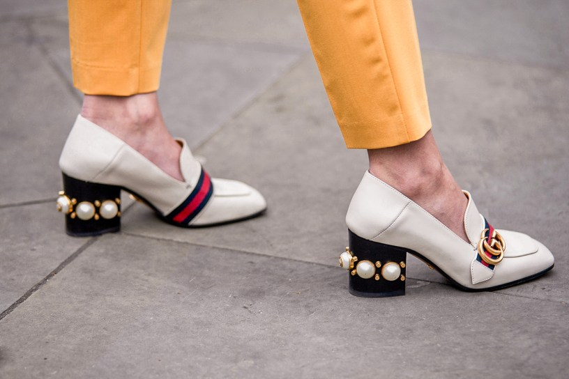Street Style during day two of London Fashion Week AW 2019. Image shows fashion blogger Kim Bouy Tang and a close up of her studded oxford heel loafer shoes by Gucci.