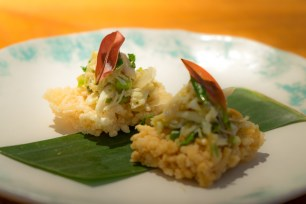 Crab with peanuts and pickled garlic on rice cakes Nahm Bangkok
