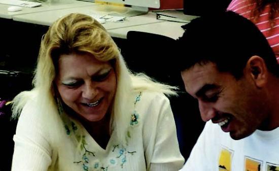 Donita Lyn Garcia (left) tutors a TRIO student in Hale Alaka'i – Cynthia Lee Sinclair
