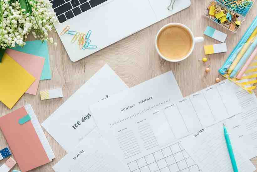 view of a desk with various items on it like someone is planning goals.