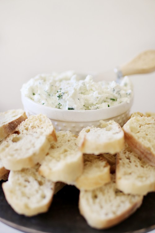 Goat Cheese and Herb Spread Appetizer. The perfect touch to entertaining guests this holiday season and one that will be a crowd pleaser! Catch the entire recipe and how-to over at Haus of Layne #EasyAppetizers #AppetizerRecipe #HolidayRecipes #EasyHolidayRecipes #HolidayAppetizerRecipe