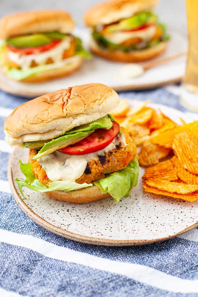 buffalo chickpea burger with lettuce, tomato, and avocado and potato chips
