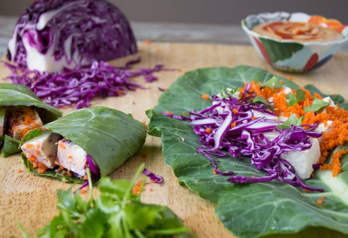 Collard Green Wraps with Tofu and Thai Peanut Sauce | @TheFoodieDietitian