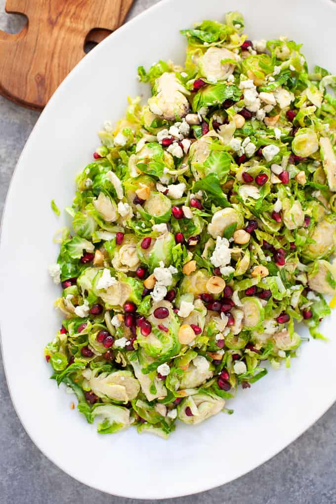 holiday shaved brussels sprout salad with pomegranate seeds and citrus dressing #holiday #salad