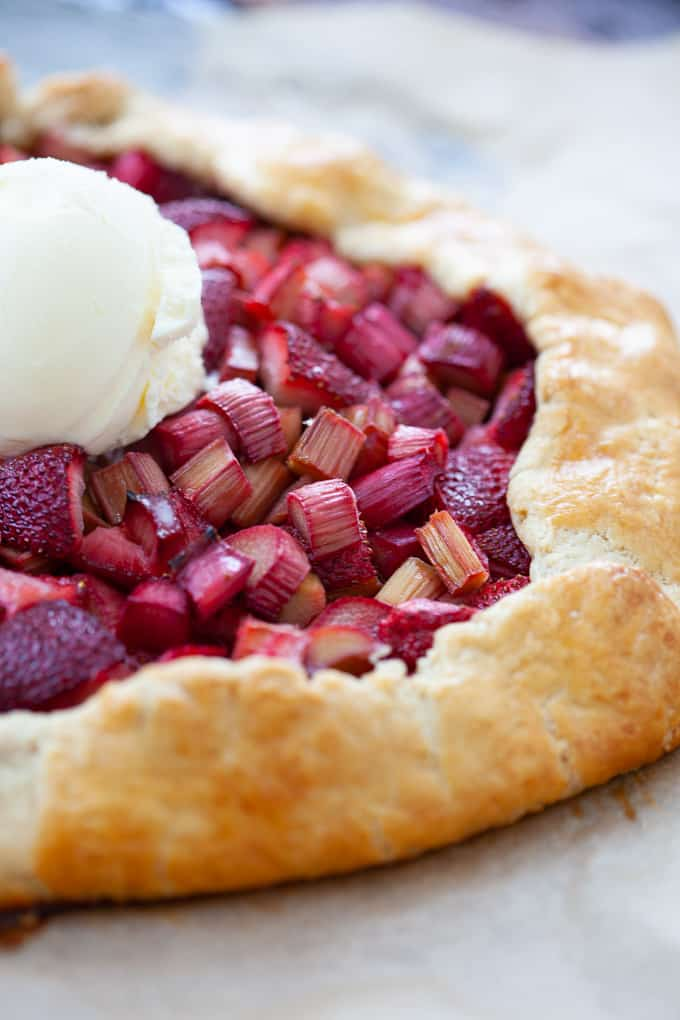 Galette made with strawberries and rhubarbs with a scoop of ice cream