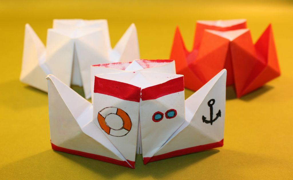 Как сделать кораблик из бумаги? Инструкция складывания бумажного кораблика своими руками этап 7