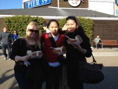 Eating the famous clam chowder in a sourdough bowl at Fisherman's Wharf.