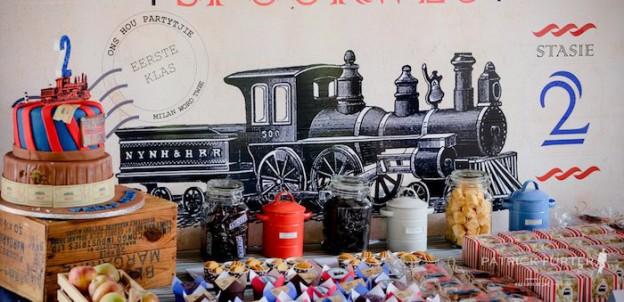 dessert table backdrop from a vintage train birthday party via kara s party ideas karaspartyideas com