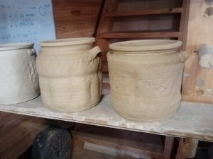 water jars. any marks in the clay need to be pretty over the top, because the glaze covers them over for the most part.