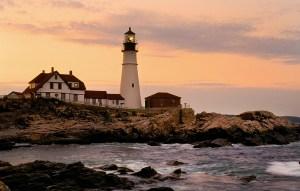 Lighthouse on rocks, sunset