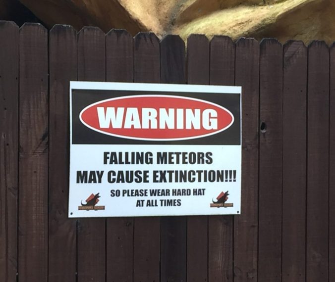 Warning falling meteors may cause extintion sign