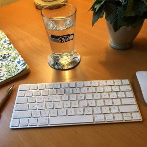 """Seahawks Glass on Desk, Thinking """"Why Not You?"""" in Your Writing Career, Karen Hugg, https://karenhugg.com/2018/12/20/writing-career/ #Whynotyou #writingcareer #RussellWilson #Seahawks #novel #books #writing"""
