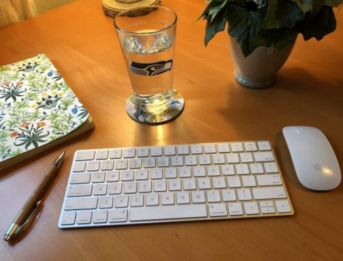 "Seahawks Glass on Desk, Thinking ""Why Not You?"" in Your Writing Career, Karen Hugg, https://karenhugg.com/2018/12/20/writing-career/ #Whynotyou #writingcareer #RussellWilson #Seahawks #novel #books #writing"