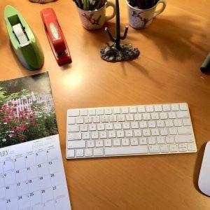 Desk With Calendar, The Weird Magic of Intention in my 2018 Year, Karen Hugg, https://karenhugg.com/2019/01/04/weird-magic-of-intention #writing #books #novel #writinglife #NewYearsResolution #intention