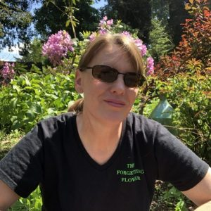 Karen Hugg in Garden, Where in the World Is the Forgetting Flower T-Shirt? Seattle, Karen Hugg, https://karenhugg.com/2019/05/24/forgetting-flower-t-shirt/ #KarenHugg #author #books #novels #gardening #plants #TheForgettingFlower #literary