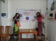 Students excitedly posing in front of their poster displaying their research.