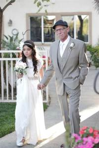 girl down aisle with dad