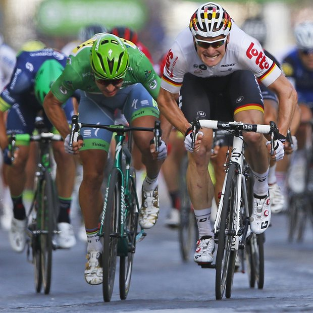 Andre Greipel beats Peter Sagan to win the final stage. Photo courtesy of Peter Dejong/AP