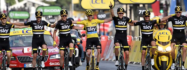 Chris Froome crosses the finish line with his teammates to win the race. Photo courtesy of Jeff Pachoud, AFP Getty Images