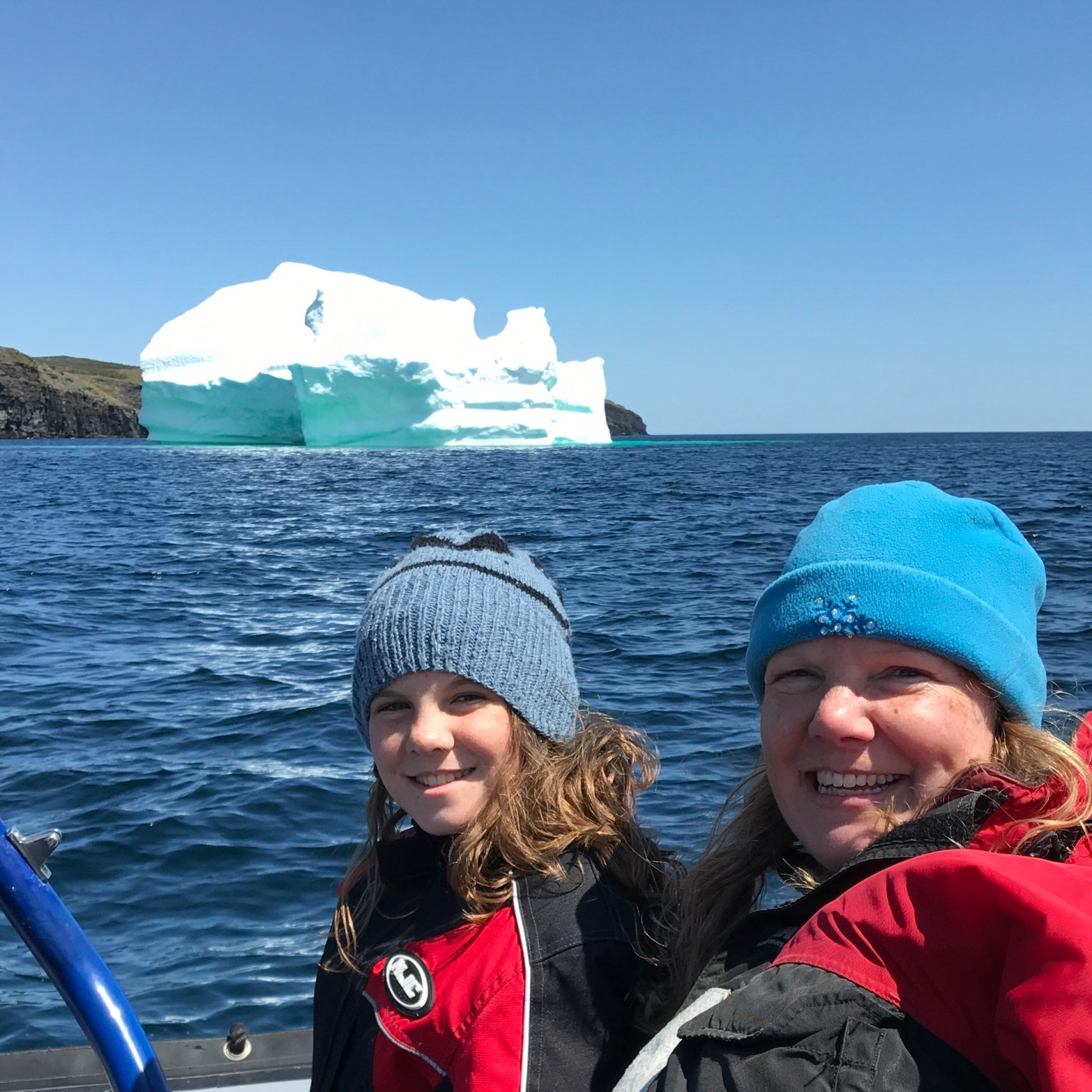 Me and my daughter on the ocean, near an iceberg.