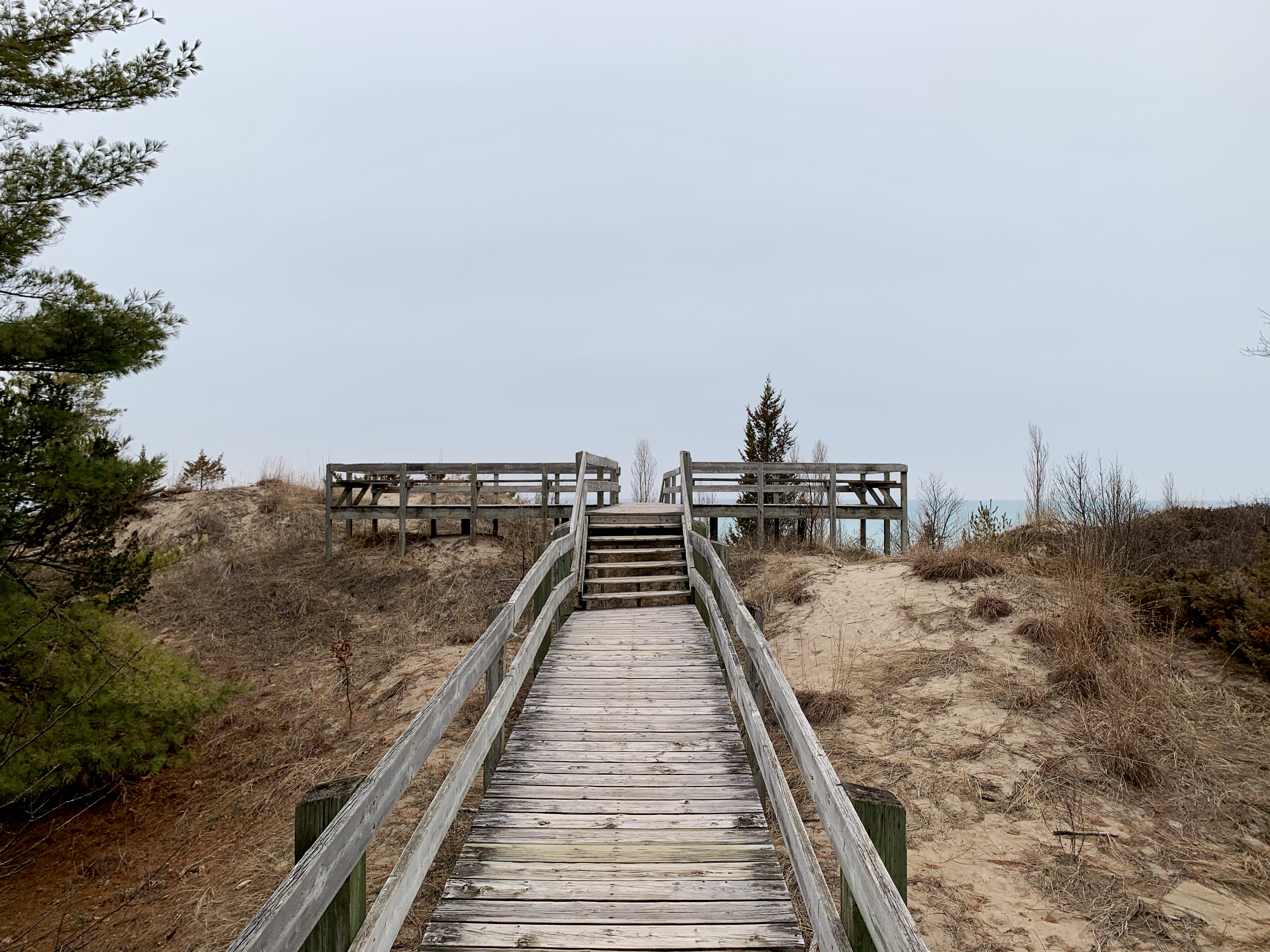 boardwalk over dunes with water in the distance