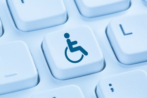 image of accessibility logo as a key on a computer keyboard