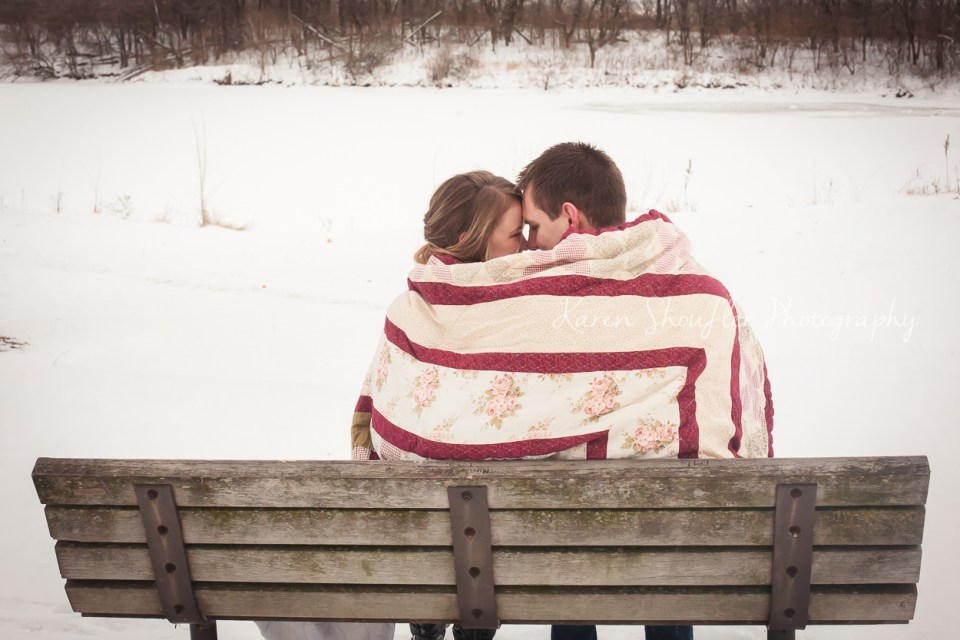 couple cuddled in the snow